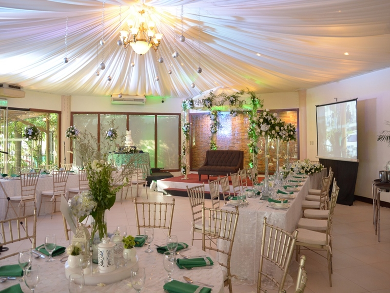 philippines white theme baby shower venue with projector screen and mini stage