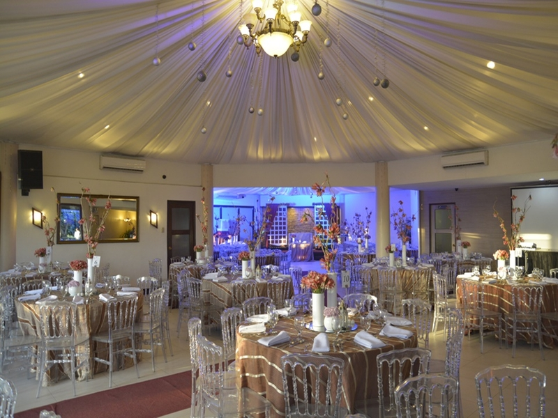 white theme wedding venue in philippines with high ceiling and banquet seating