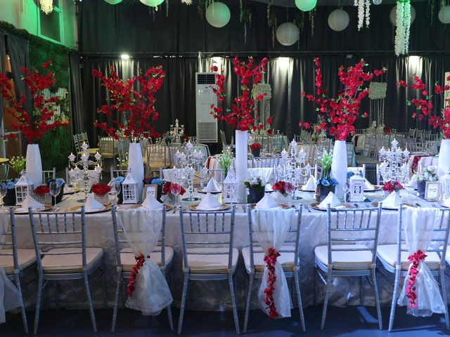 wedding reception with a lot of flower as the table decoration