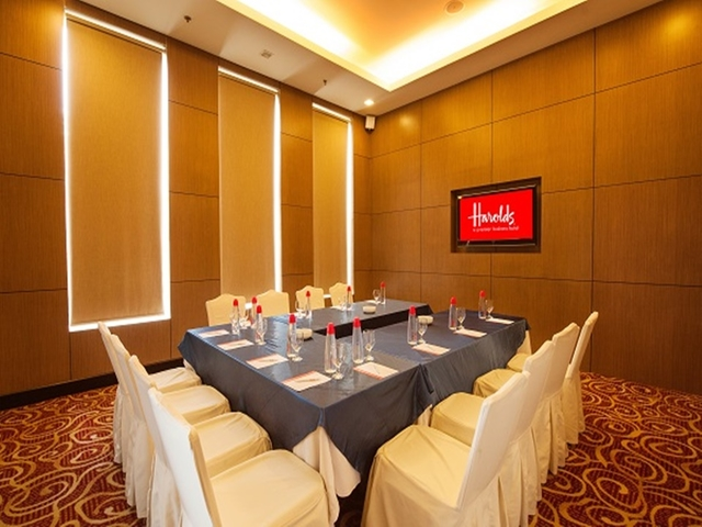private meeting room decorated with red and golden carpets