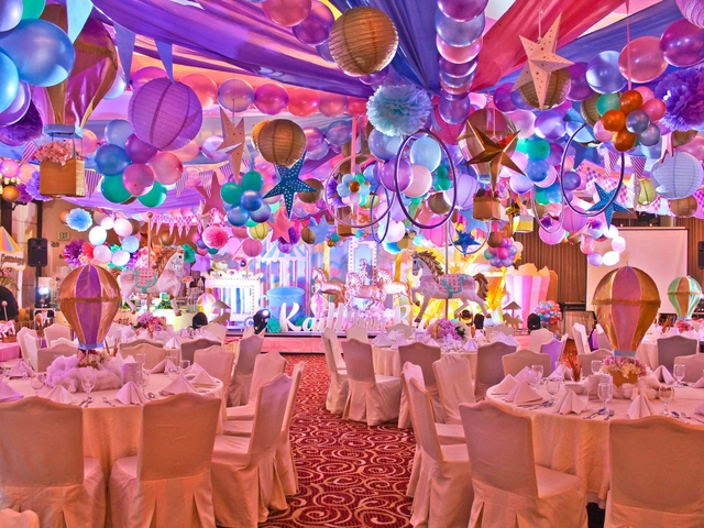 kids birthday party with colourful ballroom and stage decoration