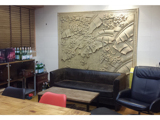 event space area with golden wallpaper art on the wall