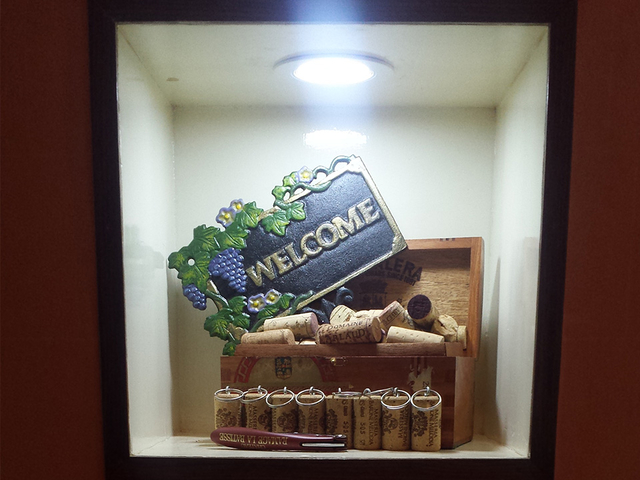 welcome signboard display on the glass box