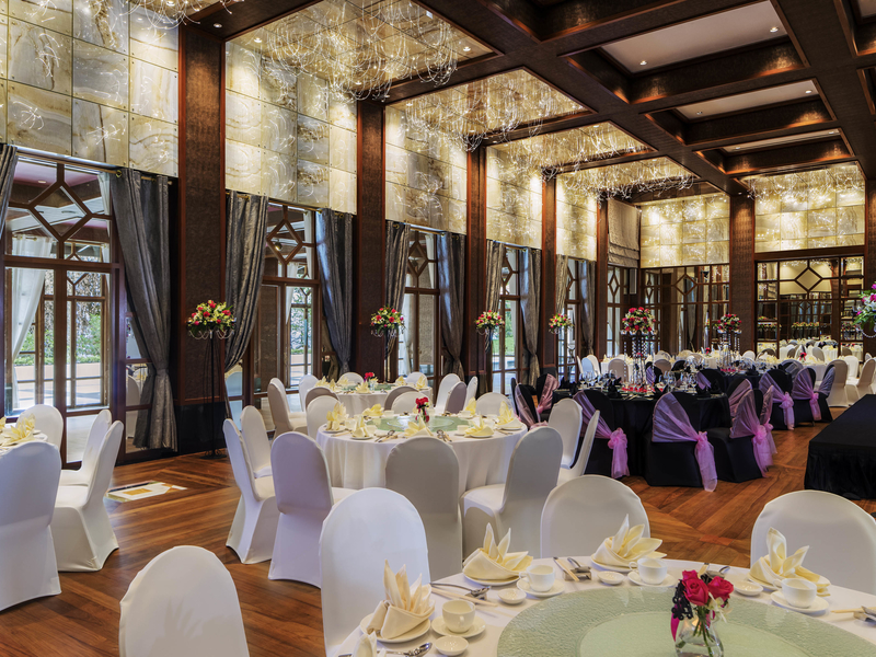 wooden floors, high ceiling, and large windows in singapore hotel ballroom