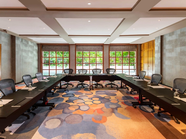 u-shaped seating meeting room in singapore with large windows