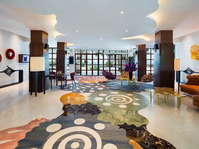 hotel in sentosa singapore with large lounge area and painted floors
