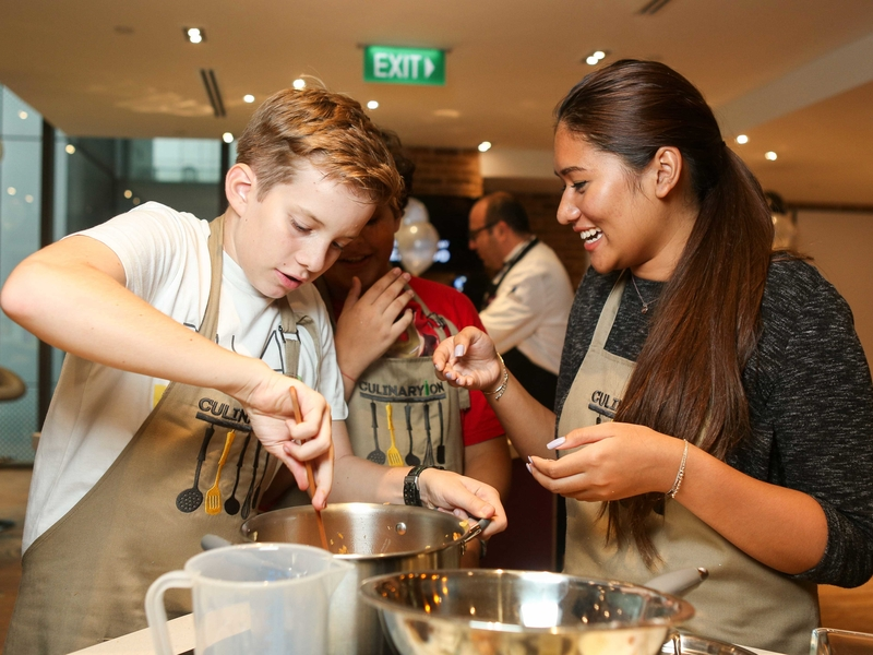 kids cooking workshop activity with their mentor