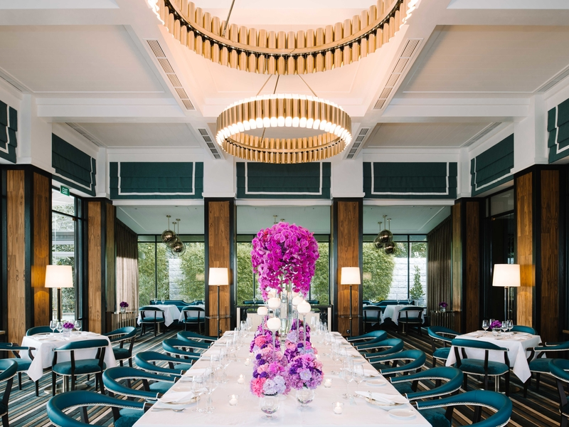 long dining table in beautiful room with elegant ceiling lamp