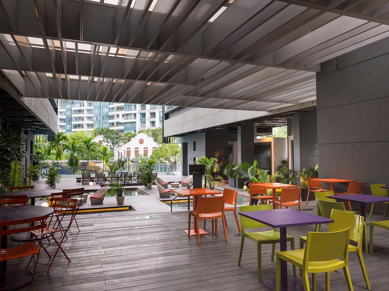 semi-outdoor event venue in singapore with colourful chairs