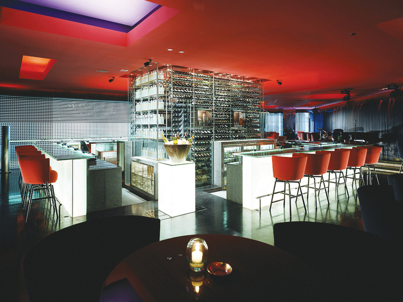 burgundy bar event space with red decoration jakarta