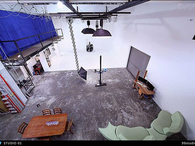 high ceiling studio with photography and videography equipment