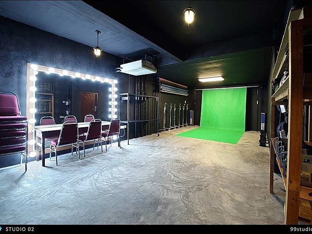 photo studio with green screen and make up area