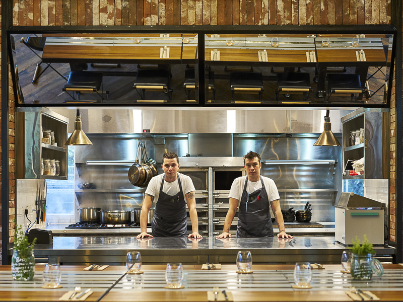 chefs standing together in the kitchen