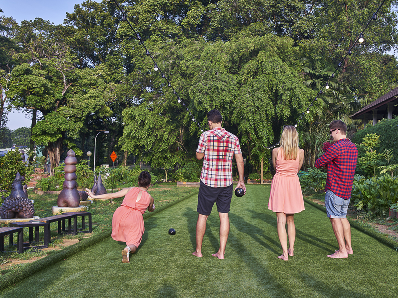 family playing game together at the garden