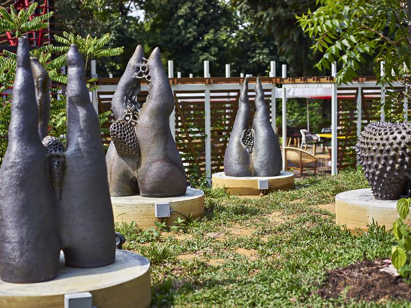garden with unique black statue