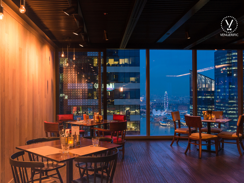 dining area with a view of the city of singapore