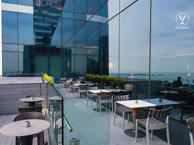 open-air terrace of cook & brew with the view of marina bay