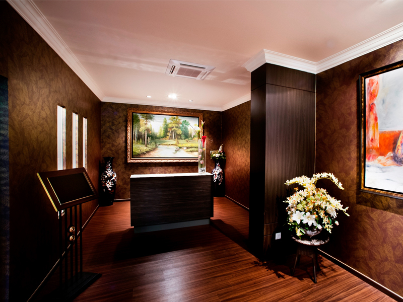 the wooden theme of the lobby by colonial at scotts