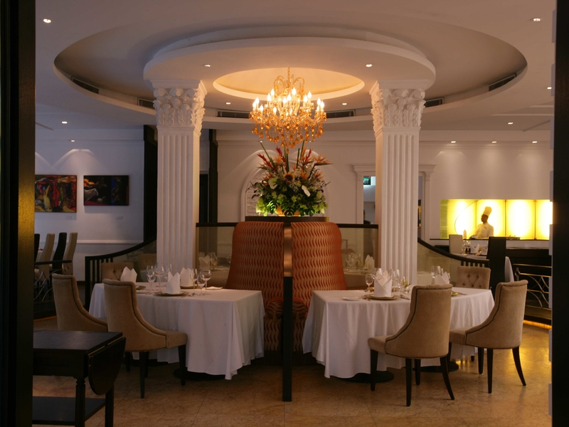 indian wedding venue in singapore with round ceiling and yellow pendant lights
