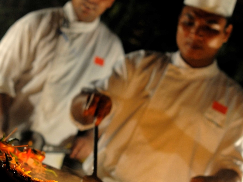 the chefs in singapore restaurant are serving Indian dishes