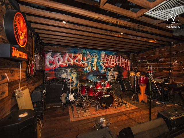 live music stage with graffiti background on the wall