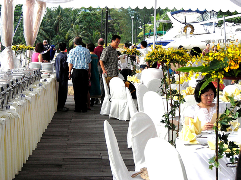 wedding party with flower decoration and buffet on the side