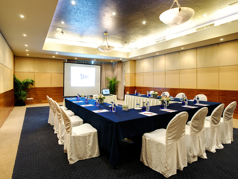 conference set up table with screen projector