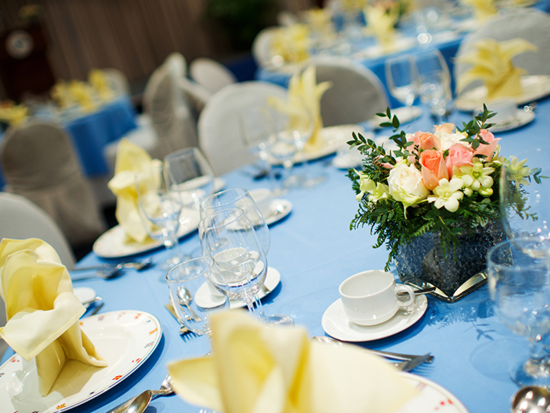 event space in singapore with blue round table and flower decoration