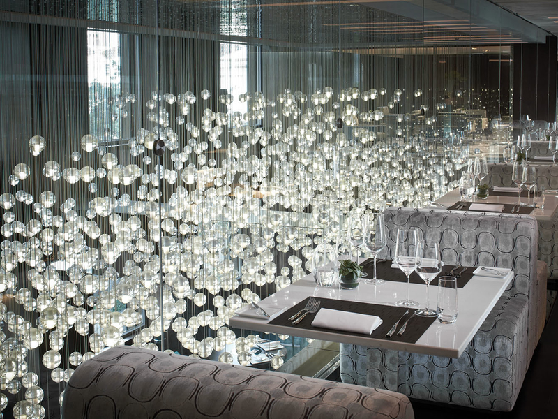 dining area with hanging bulbs view