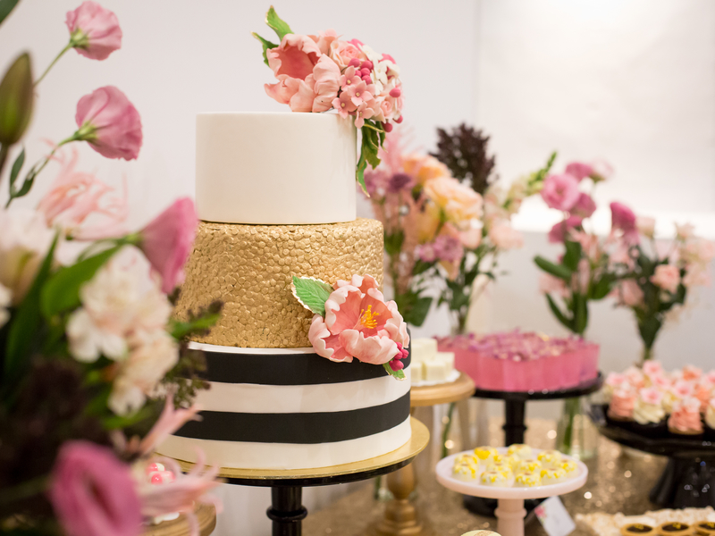 dessert table with wedding cake and decorated with flower