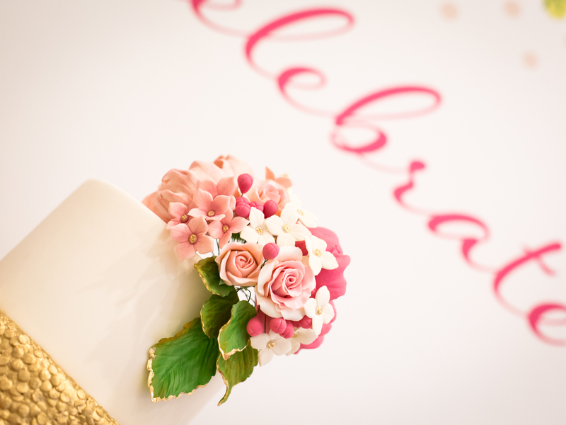 wedding cake decorated with pink flower