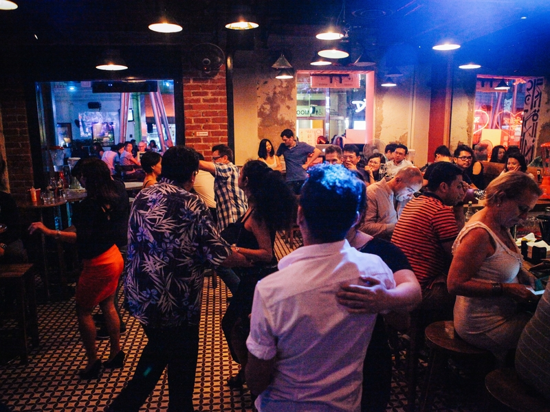 people celebrate year-end party by dancing in singapore bar