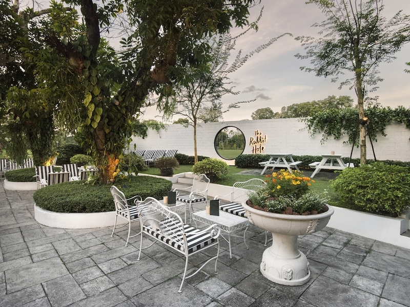large garden party venue in singapore with alice in wonderland theme