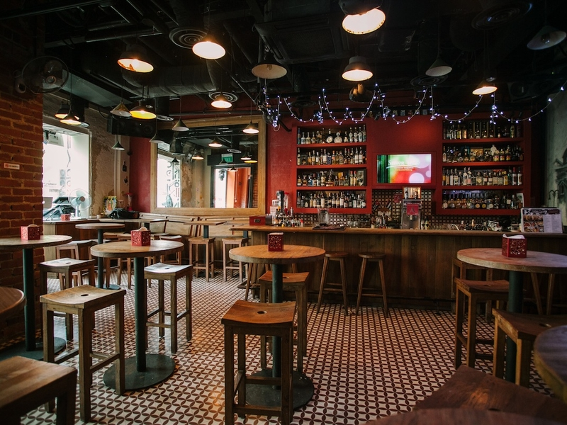 red themed bar with wooden interior and patterned floors