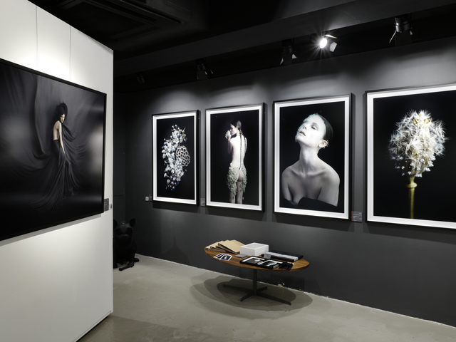 photography gallery in hong kong with a lot of collections on the wall