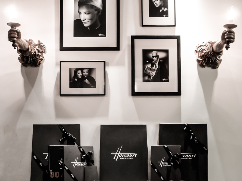 black and white potraits hanging on wall