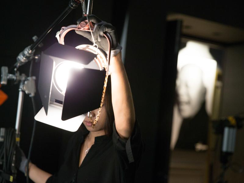 professional staff adjusting lighting setup in photoshoot