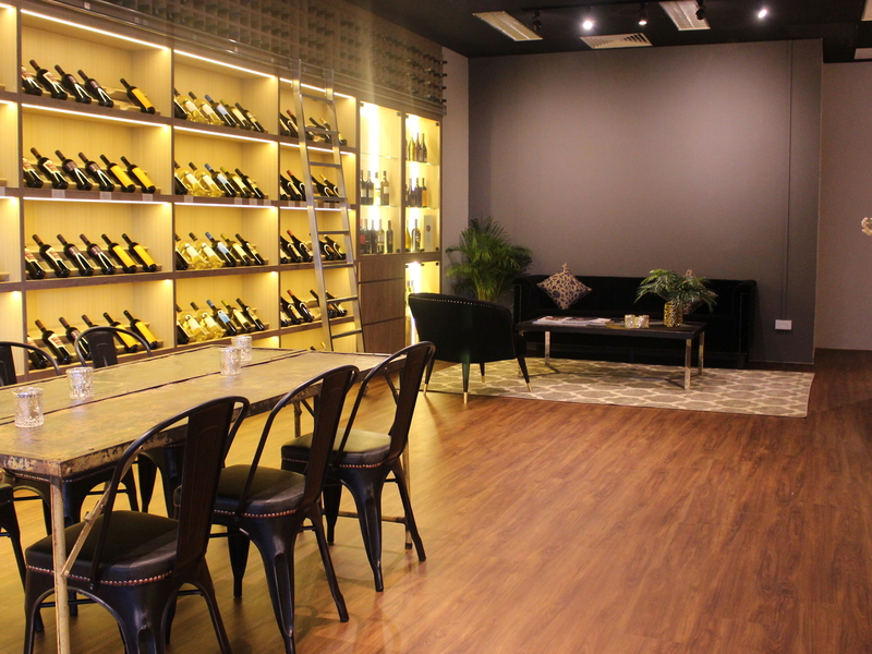 event lounge in singapore with wine selections and wooden floor