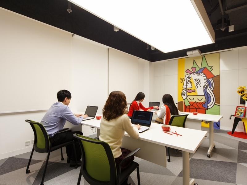 staff having meeting in small meeting room