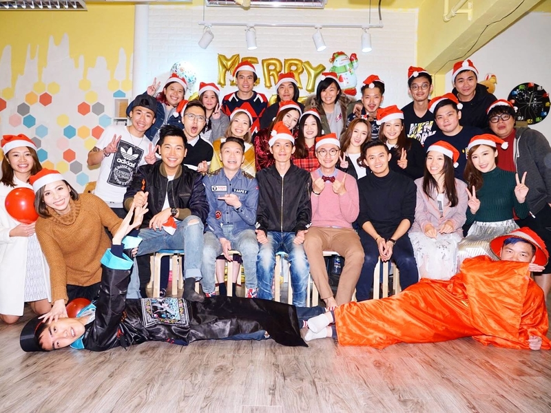 company team are celebrating christmas party using santa claus hat