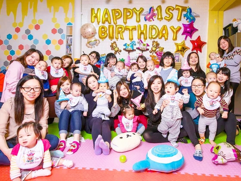 kids 1st birthday party celebration attended by mom and her baby
