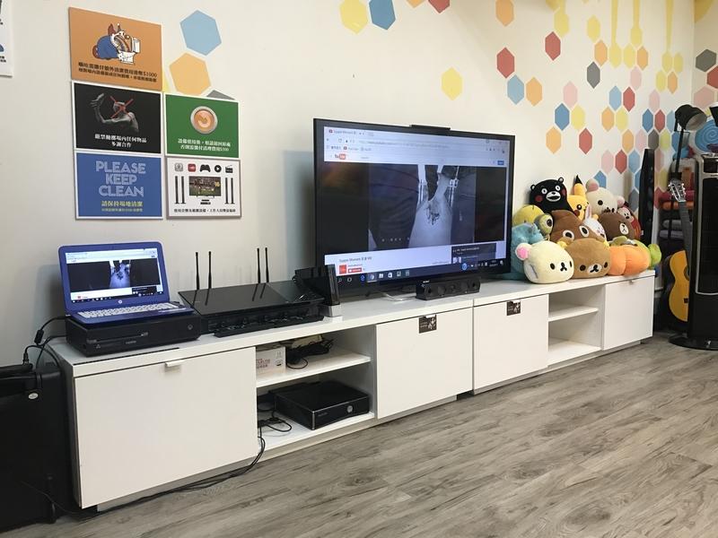 audio visual facilities and cartoon dolls at the table