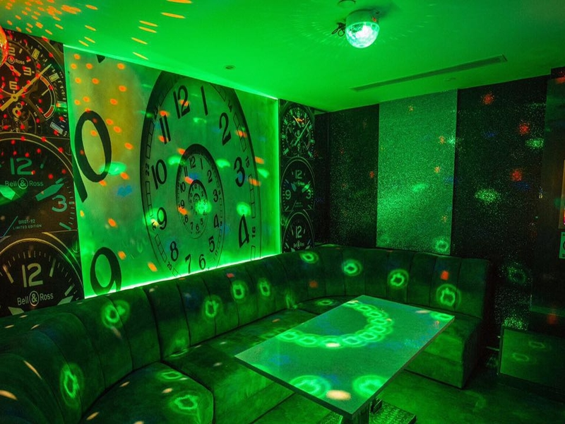 private karaoke room with clock wallpaper