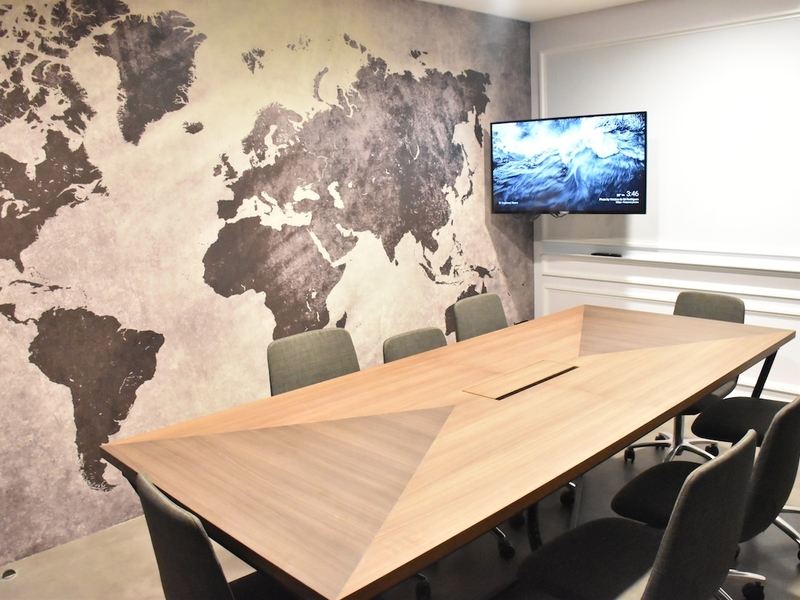 meeting room with maps wallpaper on the wall