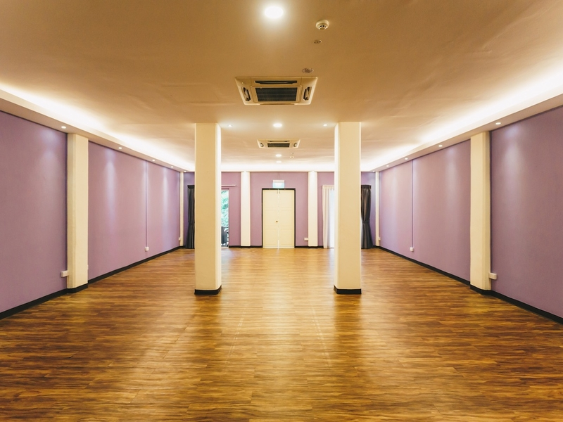 hall with wood floor with purple wall
