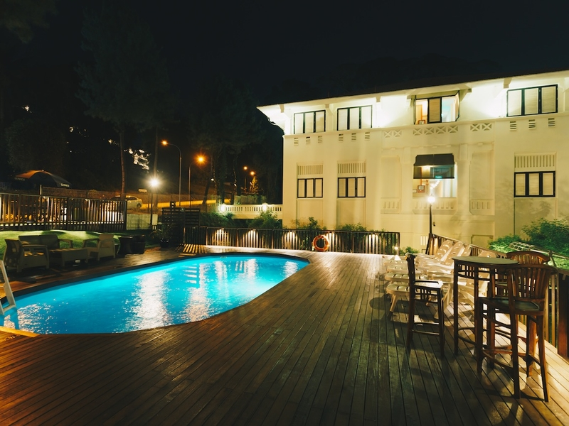 hotel with outdoor pool at night time