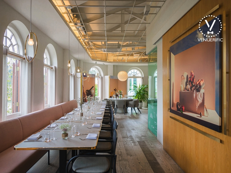 singapore restaurant with arched windows and wall painting