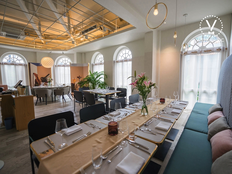 several arched windows and long tables in singapore restaurant