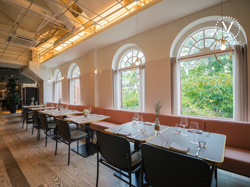 several arched windows and long couch in singapore restaurant