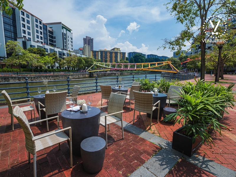 singapore river view restaurant with several round tables